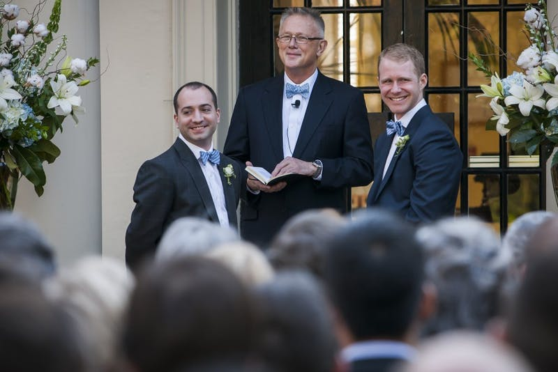 FROM LEFT: Zach Howell, officiant Dr. Jesse L. White Jr, and Garrett Hall (ALL CQ) during the first same-sex wedding ceremony ever at The Carolina Inn in Chapel Hill, NC.  on April 6, 2013.