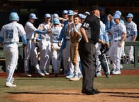 The Tar Heels celebrate as game tying runs in the bottom of the third  come across the plate against USF on Sunday, Feb. 24, 2019 at Boshamer Stadium.