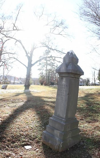 In a ceremony at Margaret Lane Cemetery in Hillsborough, a new brick monument designed to preserve three headstones  from unknown grave  sites was unveiled.