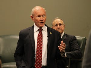 General Martin Dempsey, former Chairman of the U.S. Joint Chiefs of Staff, discusses U.S. national security at a forum with Professor Richard Kohn and Professor Klaus Larres on Tuesday evening in Wilson Library.