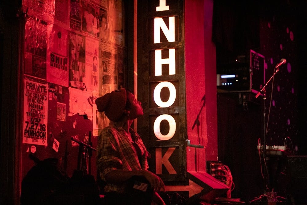 Essi Novelli, a 20-year-old singer from Raleigh, watches a performance at the Pinhook on Dec. 2, 2019.