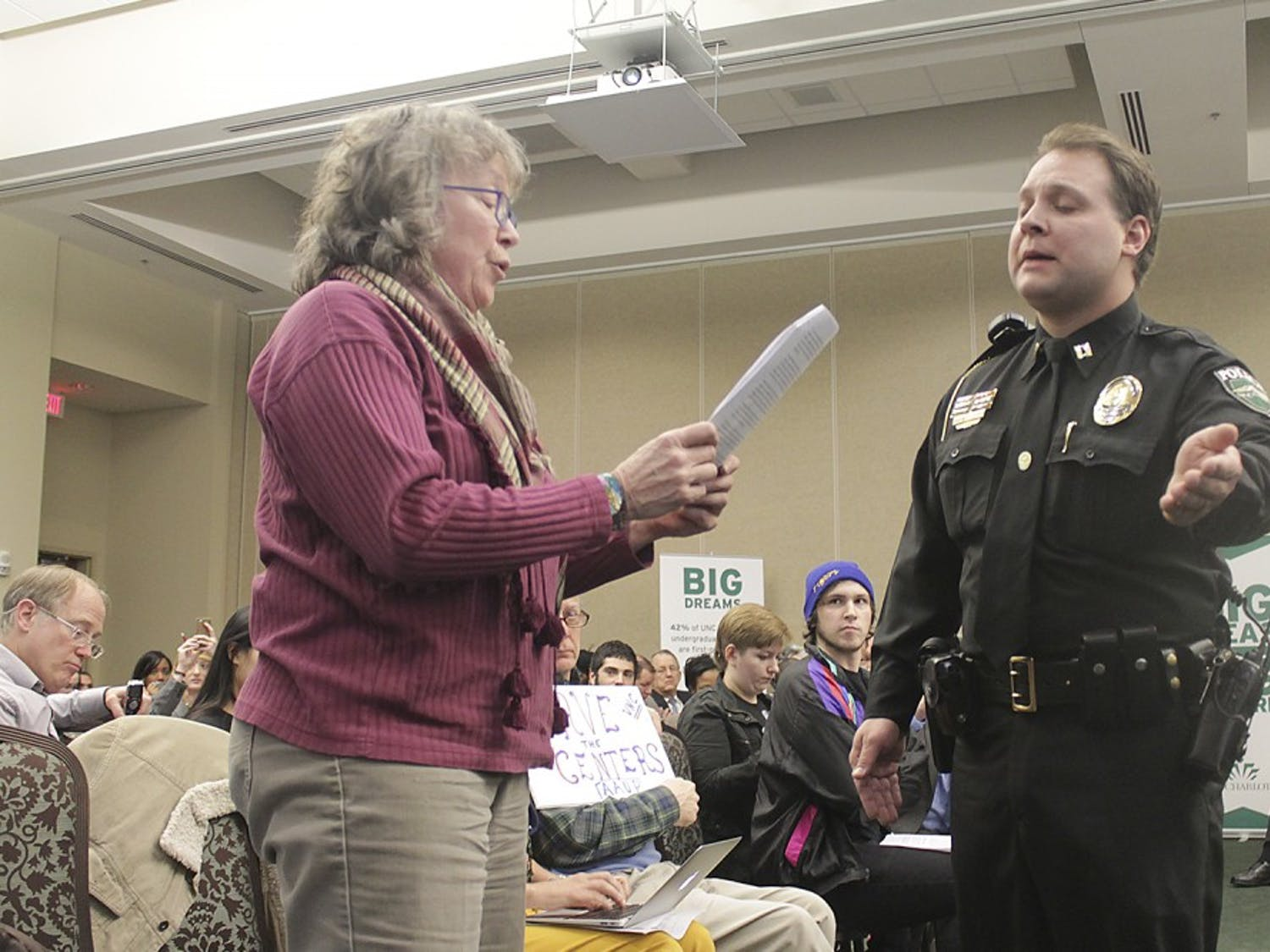 UNC geography professor Altha Cravey reads aloud a statement in support of the poverty center at the UNC-system Board of Governors meeting on Friday, Feb. 27 in Charlotte. The board voted unanimously to shut down three centers.