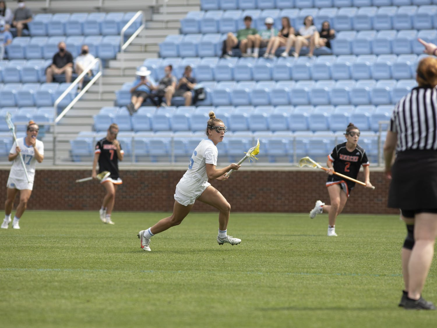 Graduate defender Catie Woodruff (16) looks for an opportunity to pass the ball in a game against Mercer at Dorrance Field on March 27, 2021. UNC beat Mercer 18-5.