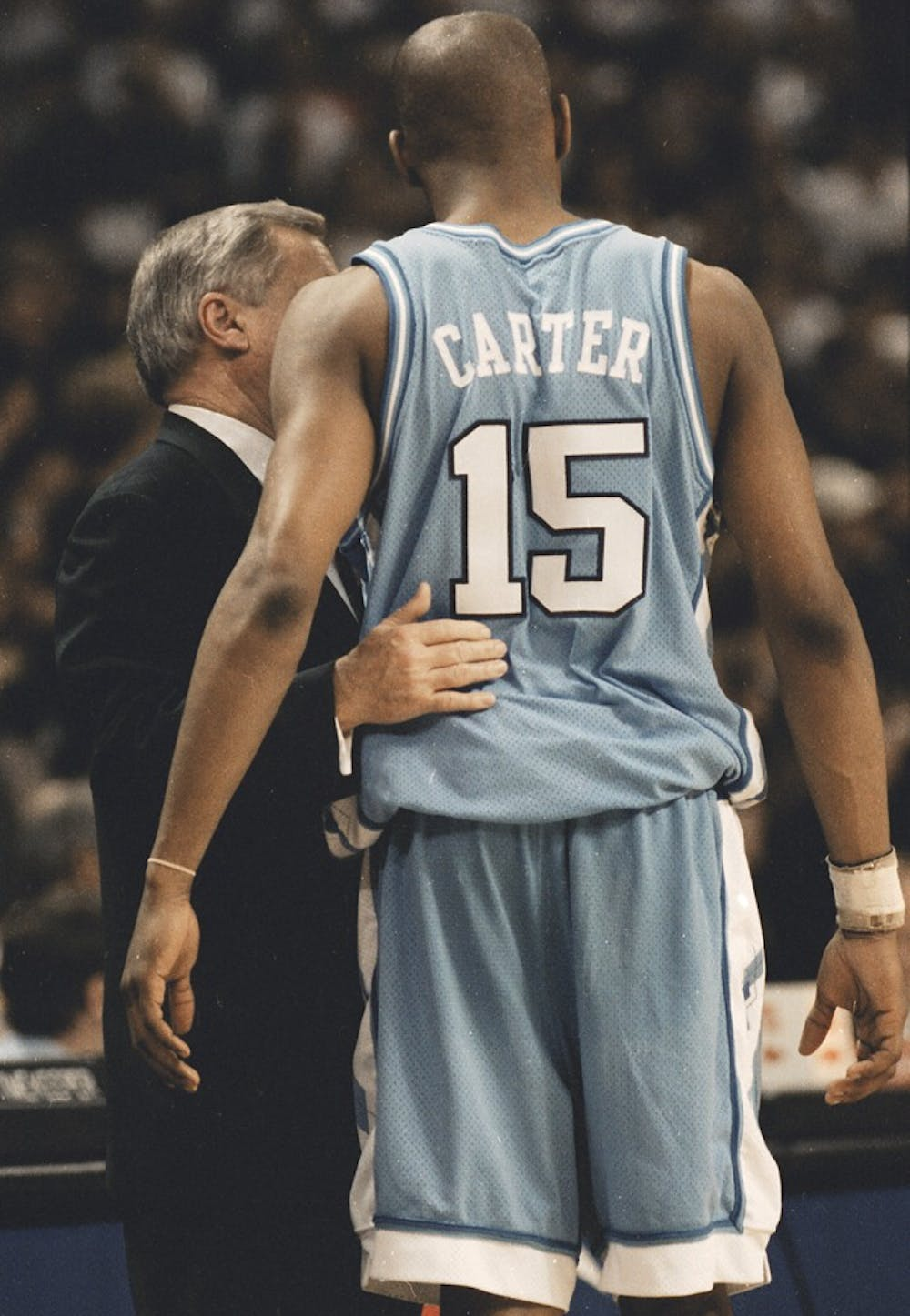 <p>Dean Smith talks to Vince Carter during the Feb. 27, 1996 game against Wake Forest. The Demon Deacons won 84-60. DTH File/Erik Perel.</p>