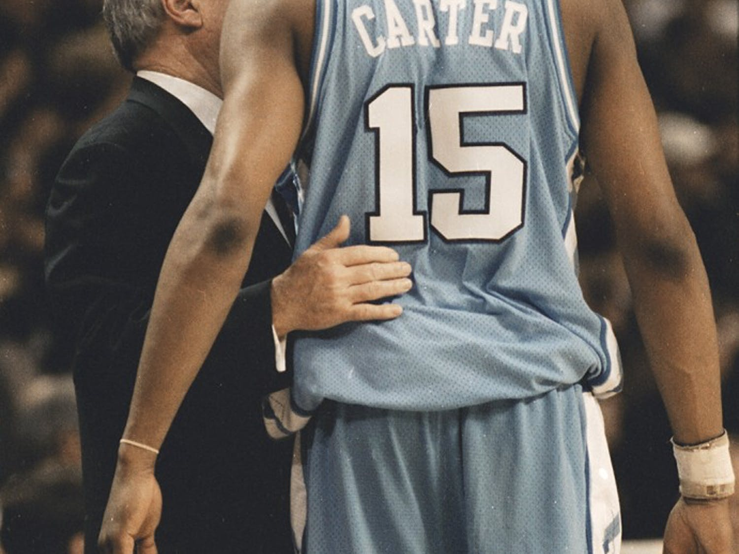 Dean Smith talks to Vince Carter during the Feb. 27, 1996 game against Wake Forest. The Demon Deacons won 84-60. DTH File/Erik Perel.