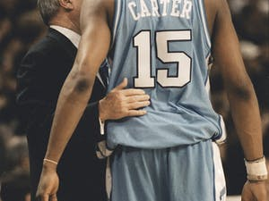 Dean Smith talks to Vince Carter during the Feb. 27, 1996 gameagainst Wake Forest. The Demon Deacons won 84-60.DTH File/Erik Perel.