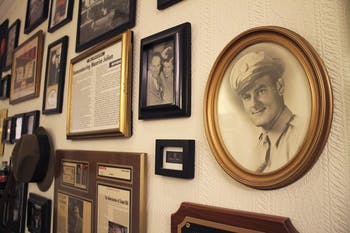 Photos and articles commemorating business leader Maurice Julian (right) and his family hang on the back wall in Julian's on Franklin Steet.
