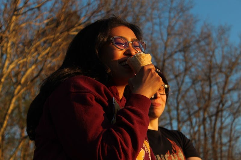 Duke students Annu Dahiya, 28, and MD Murtagh, 29, eating ice cream at Maple View Ice Cream on Sunday, March 17, 2019. Murtagh says that ice cream becoming the state frozen dessert of NC is one thing that Blue Devils and Tar Heels can come together on. Dahiya believes that ice cream is a good choice for the NC state frozen dessert because it can be inclusive with vegan options. Maple View Ice Cream is delighted to hear that ice cream could be the state dessert.