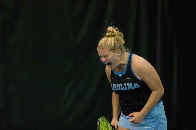 First-year Alle Sanford celebrates during a March 2 match against Boston College in the Cone-Kenfield Tennis Center.