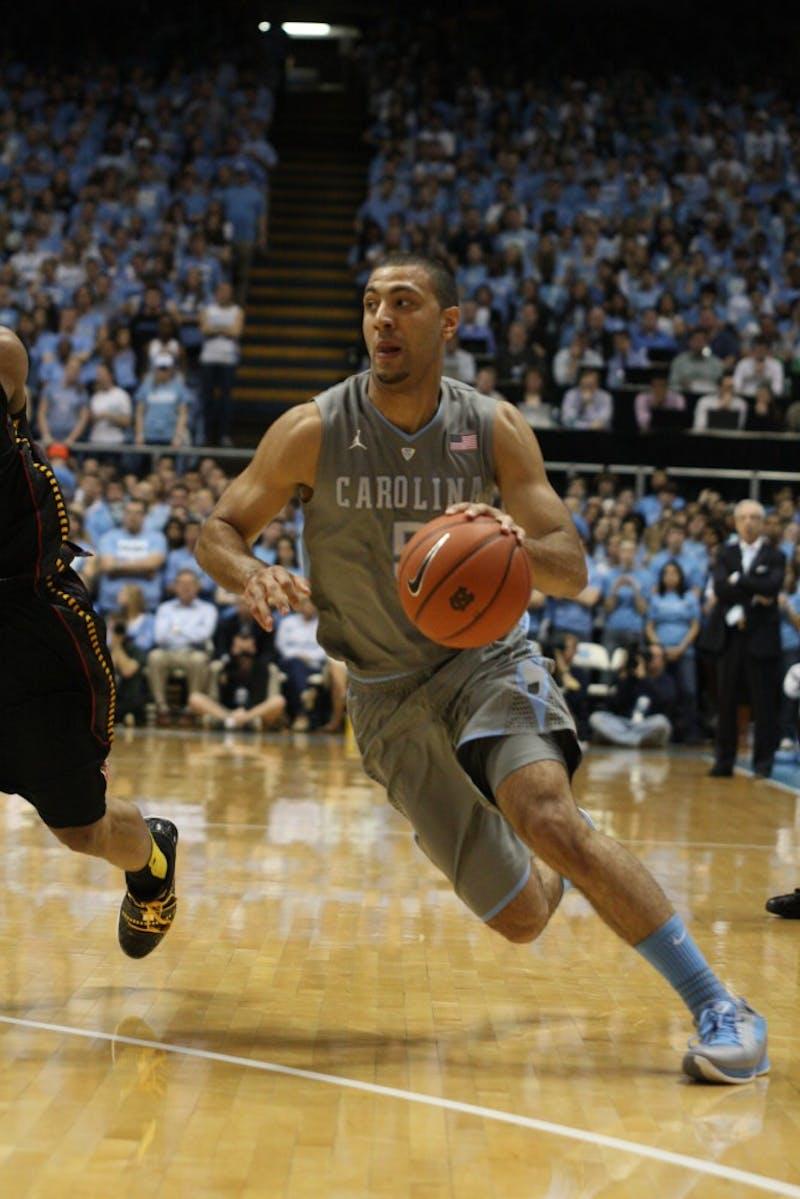 Kendall Marshall dribbles toward the basket