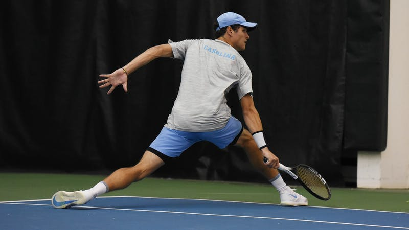 Ladd Harrison swings during a match against NCCU at the Cone-Kenfield Tennis Center on Saturday, Jan. 18, 2020. Photo by Rebecca Lawson.