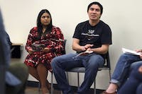 Jazmin Posas (left) and Ramon Zepeda of Student Action with Farmworkers joined UNC student organization FLO (fair, local, organic) to host a film screening and Thanksgiving potluck on Monday evening.