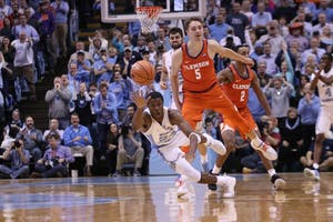 North Carolina guard Kenny Williams (24) reaches for the ball during Tuesday night's home game against Clemson.