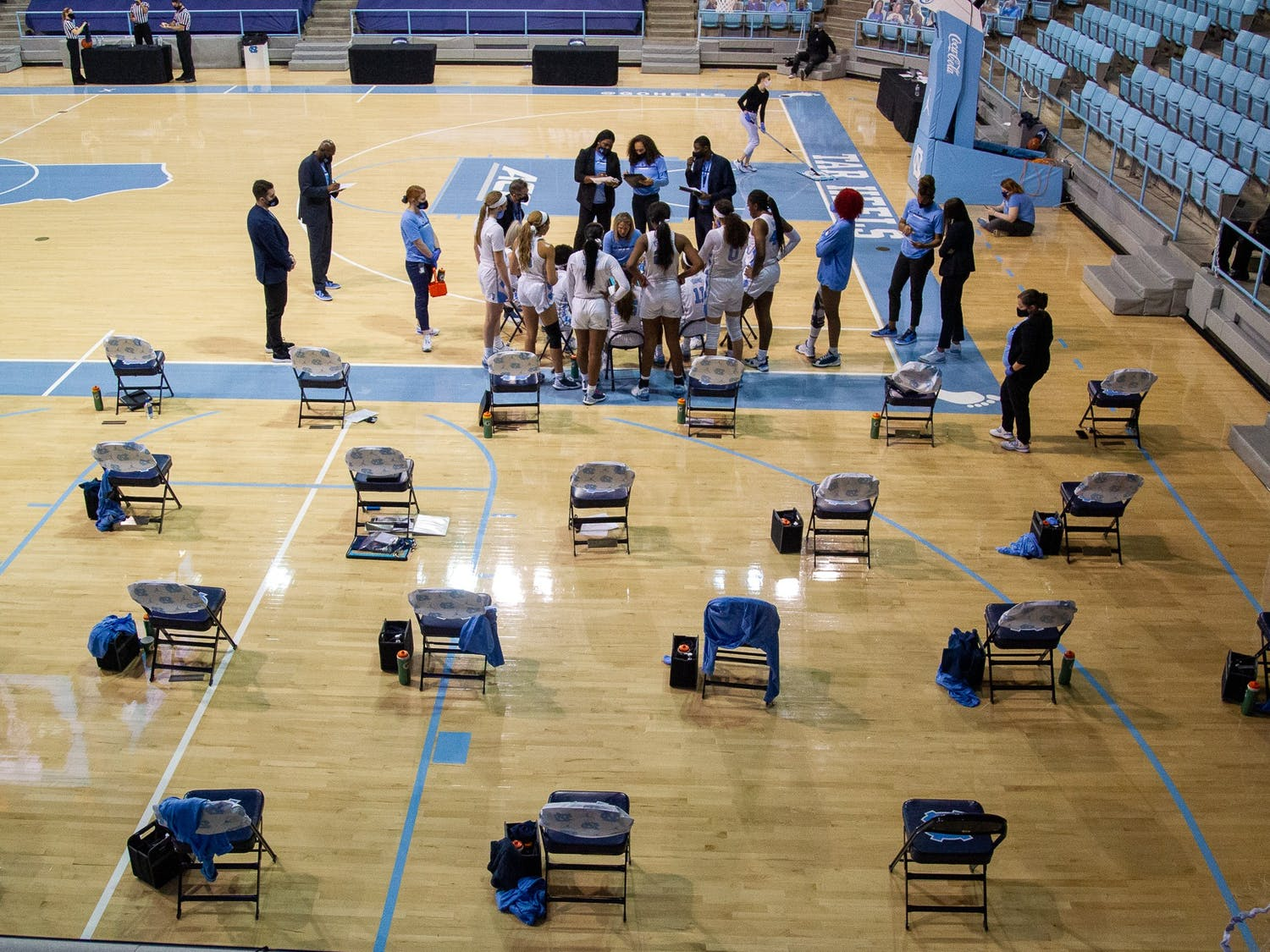 The UNC team huddles in Carmichael Arena on Jan. 14, 2021 in Chapel Hill, N.C. The Tar Heels lost to the Hokies 66-54.