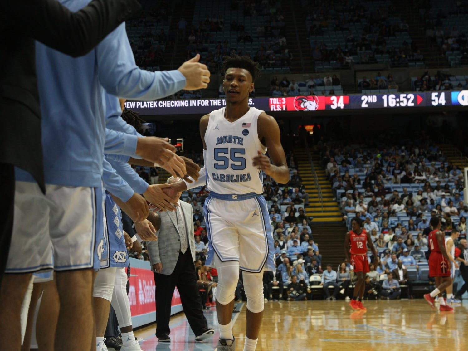 Graduate guard Christian Keeling (55) daps up his teammates during the exhibition game against Winston Salem State in the Smith Center on Friday, Nov. 1, 2019. UNC beat WSSU 96-61.