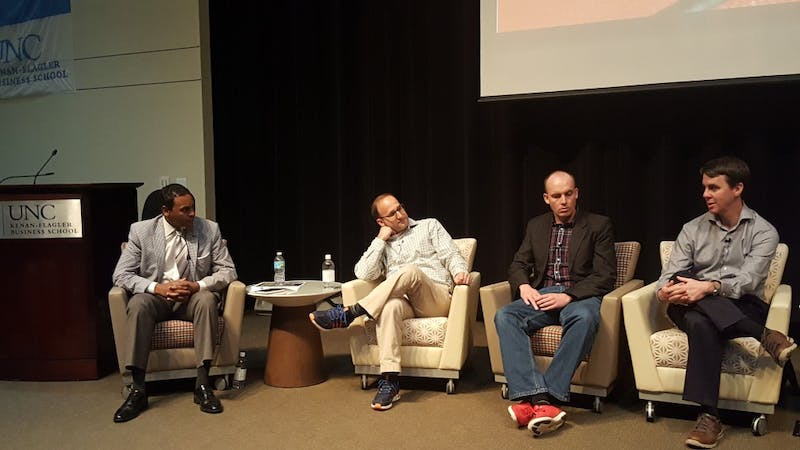 Dwayne Ballen (left) moderates a panel with Gabe Farkas, Patrick Lucey and Ken Pomeroy at the SPEIA Basketball Analytics Summit hosted at Kenan-Flagler Business School on Saturday.