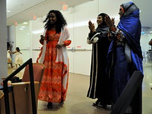 Lina Abdulrhman, a UNC-Charlotte undergraduate alumni, models a modern-day Tigrinya dress at an Eritrean Fashion Show sponsored by Campus Y and the GPSF on Wednesday, April 24, 2019 at the Genome Sciences Building.