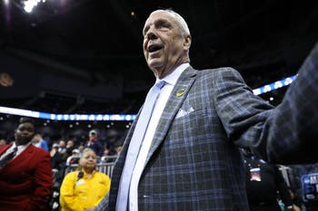 Head Coach Roy Williams high-fives fans as he enters the arena for UNC's match-up against Auburn in the Sweet 16 of the NCAA Tournament on Friday, March 29, 2019 at the Sprint Center in Kansas City, M.O. UNC lost 97-80 against Auburn.