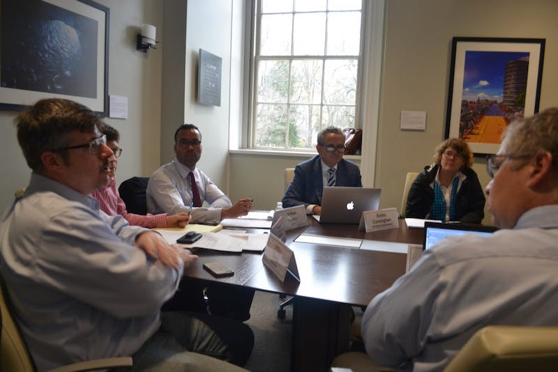 Jaye Cable, Bubba Cunningham, William Sturkey, Lissa Broome, and Jeffrey Spang discuss the minutes during the Faculty Executive Committee on Tuesday afternoon.