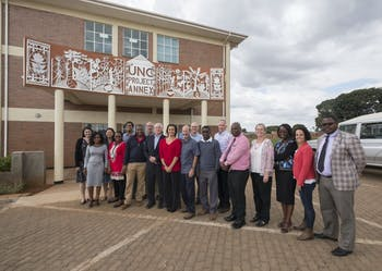 UNC Project-Malawi leadership team poses outside of the new annex building in Lilongwe, Malawi in June 2017. The annex building houses the project's state-of-the-art pathology laboratories.   Photo by Jon Gardiner. Photo courtesy of UNC Project-Malawi.