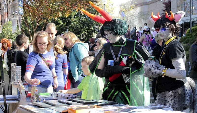 (From Left)Talia Lombardo and Carina Lombardo dress up for the Comic-Con hosted by the Durham Convention Center on Sunday.