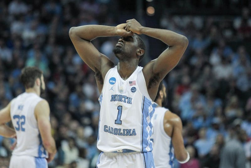 Theo Pinson (1) puts his hands over his head during UNC's loss to Texas A&M in the second round of the NCAA Tournament on March 18 in Charlotte.