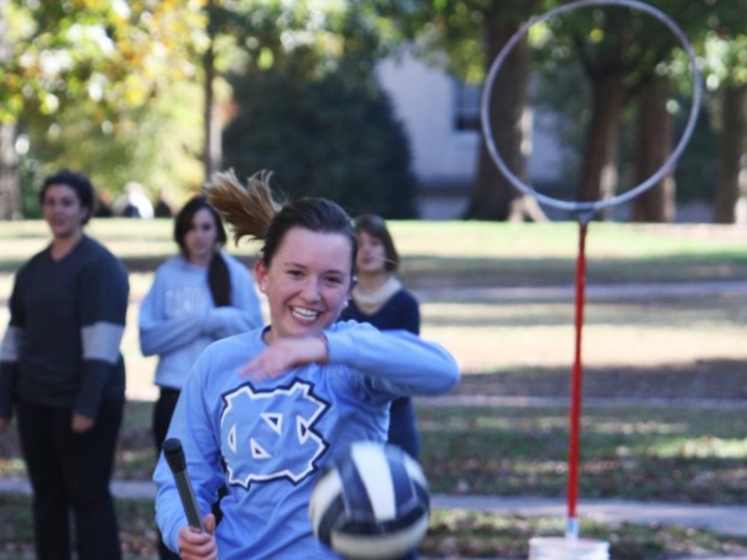 Archaeology and economics double major Sam Kiefer plays Quidditch with the UNC Quidditch team on Polk Place earlier this month.