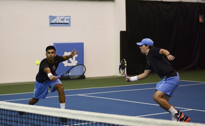 Anu Kodali (left) returns a backhand volley at the net with doubles partner Ronnie Schneider (right) in Saturday's match against Ole Miss.