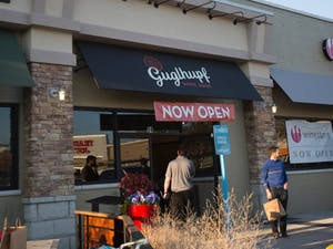 Customers walk in and out of the newest bakery in the Eastgate shopping center, Guglhupf, on Friday, Dec. 1.