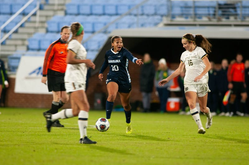 UNC sophomore forward/midfielder Rachel Jones (10) directs a teammate during the Tar Heels' 3-0 victory over Notre Dame at Dorrance Field on Sunday, Nov. 3, 2019.
