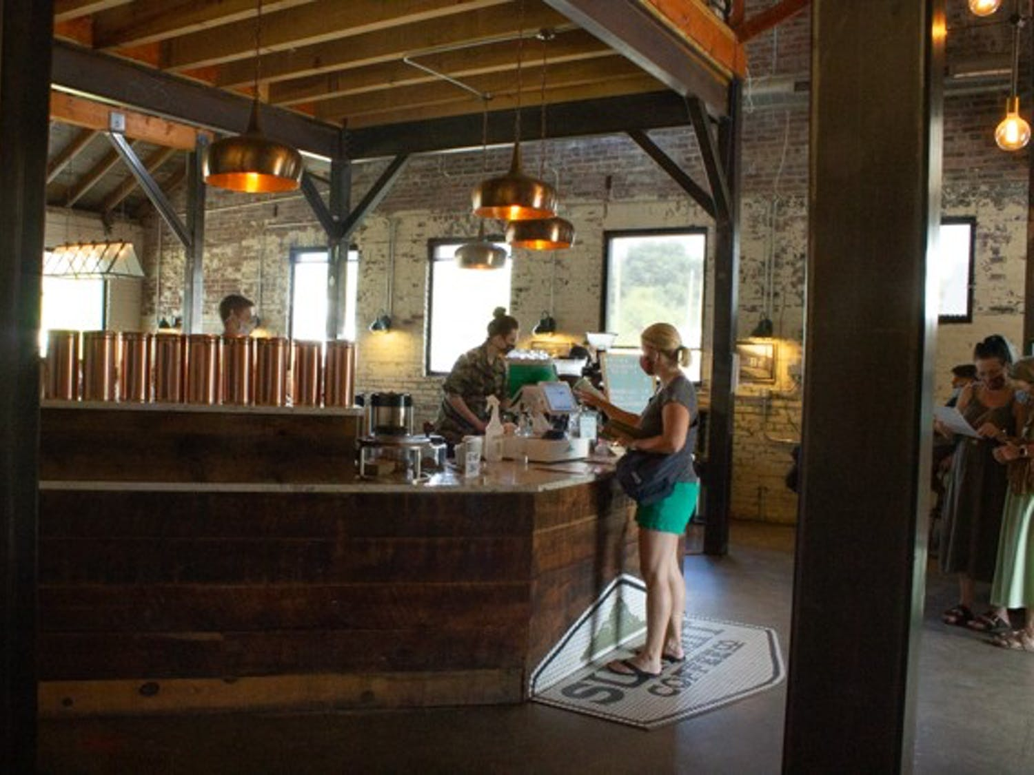 A line of customers visit Summit Coffee in Asheville on Sunday, Sept. 6.