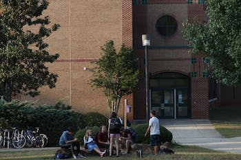 Students at East Chapel Hill High School spend time outside after school is let out.