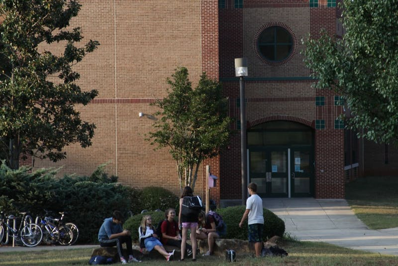 Students at East Chapel Hill High School spend time outside after school is let out. Both Chapel Hill-Carrboro City Schools and Orange County Schools are facing a funding crisis due to proposed legislation that would reduce the size of elementary school classes.