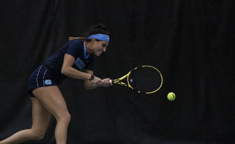 UNC senior Alexa Graham swings at her opponent's serve on Sunday, Feb. 2, 2020. Graham won her first set 6-4, and 6-2 in the second set. UNC beat Vanderbilt 7-0 overall.
