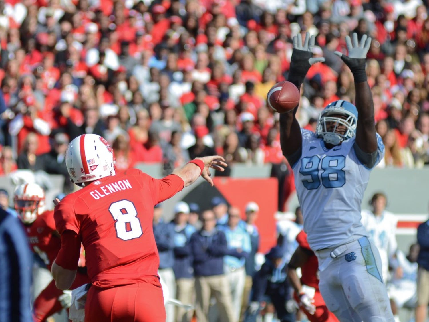UNC defensive end Donte Paige-Moss attempts to block NC State quaterback Mike Glennon's pass in UNC's 13-0 loss to NC State at Carter-Finley Stadium in Raleigh, NC.