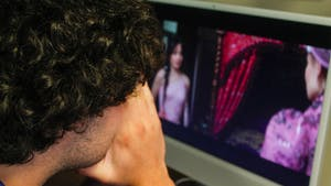 City and State Editor, Guillermo Molero, covers his face in disgust as he watches the new movie, Cinderella.
