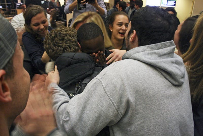 Bradley Opere celebrates with his campaign team as the new Student Body President.