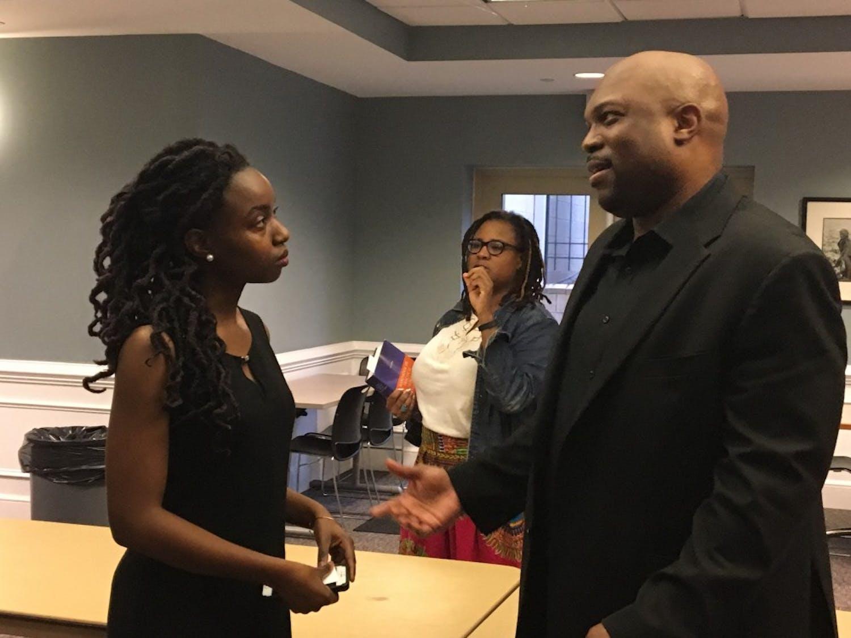 Panelist Mistyre Bonds and speaker OJ McGhee talk at the 2018 Wilson Caldwell Day.