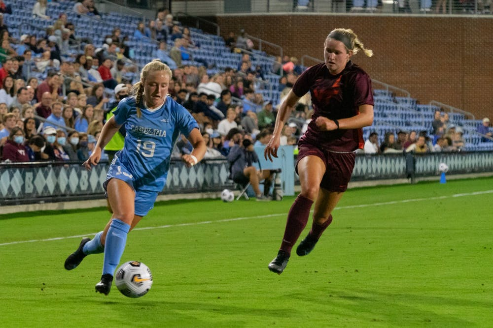 <p>UNC first-year midfielder Emily Colton (19) runs with the ball at the game against Virginia Tech on Sept. 23 at Dorrance Field.</p>