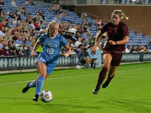 UNC first-year midfielder Emily Colton (19) runs with the ball at the game against Virginia Tech on Sept. 23 at Dorrance Field.