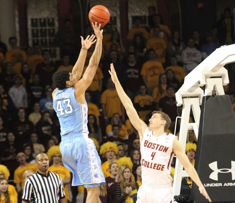 James Michael McAdoo goes up for a contested shot against Boston College's Eddie Odio.