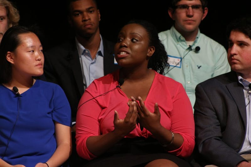Raleigh Charter High School Senior Kari Degraffenreid voices her opinion on gun violence at the Reverse Town Hall in the Stone Center on April 22.