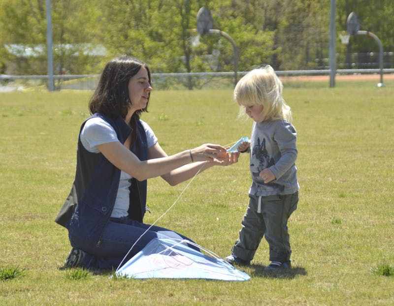 Carrboro Kite Fly takes place on Sunday Apr.17  from 1PM to 3 PM at Hank Anderson Park. Andrea Wood (left) from Carrboro is teaching her two-year-old son Rye Jones(right) to fly a kite.