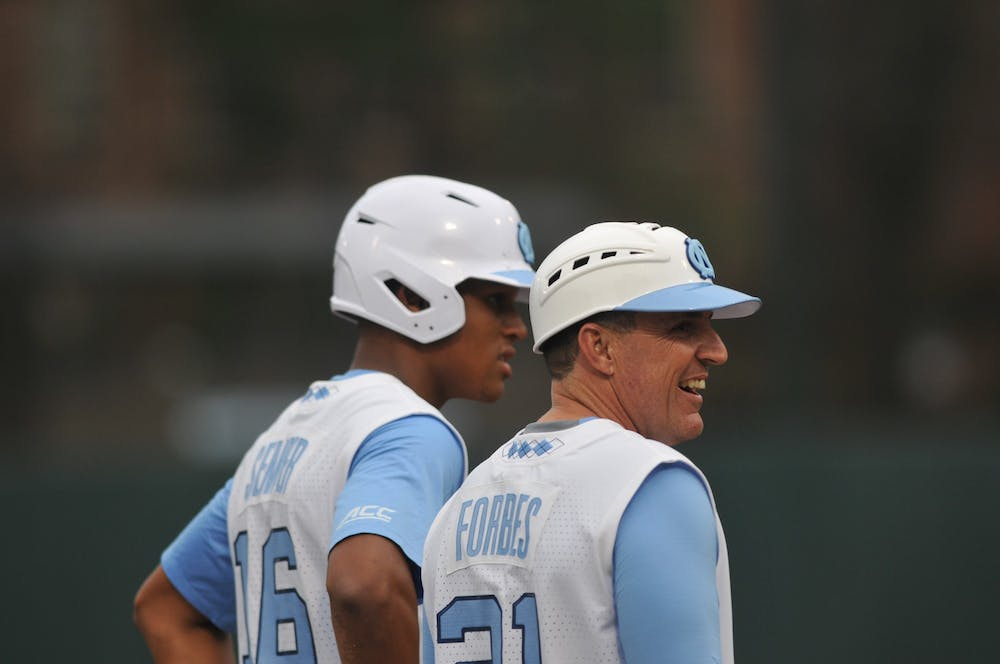 <p>Earl Semper (16) talks to new baseball head coach Scott Forbes while waiting on third base on Tuesday, Feb. 25, 2020 in Boshamer Stadium against NC A&amp;T. UNC beat NC A&amp;T 8-0.</p>