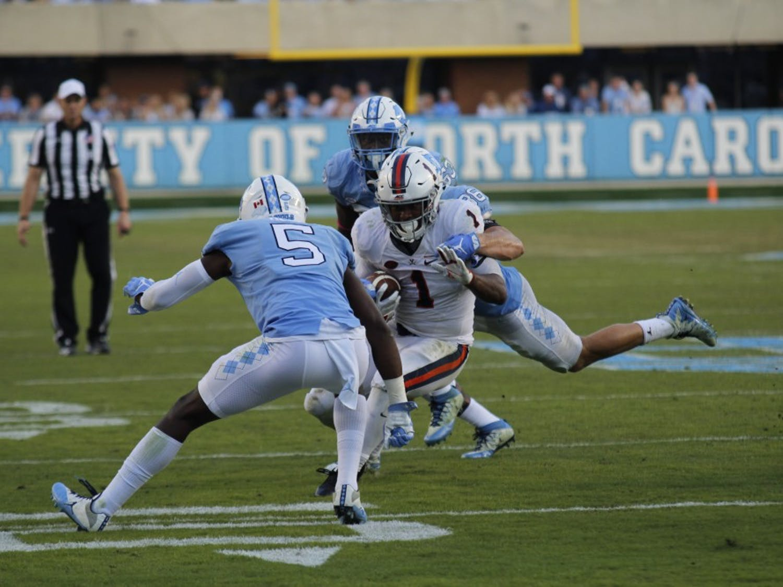 North Carolina cornerback Patrice Rene tackles Virginia running back Jordan Ellis on Saturday.