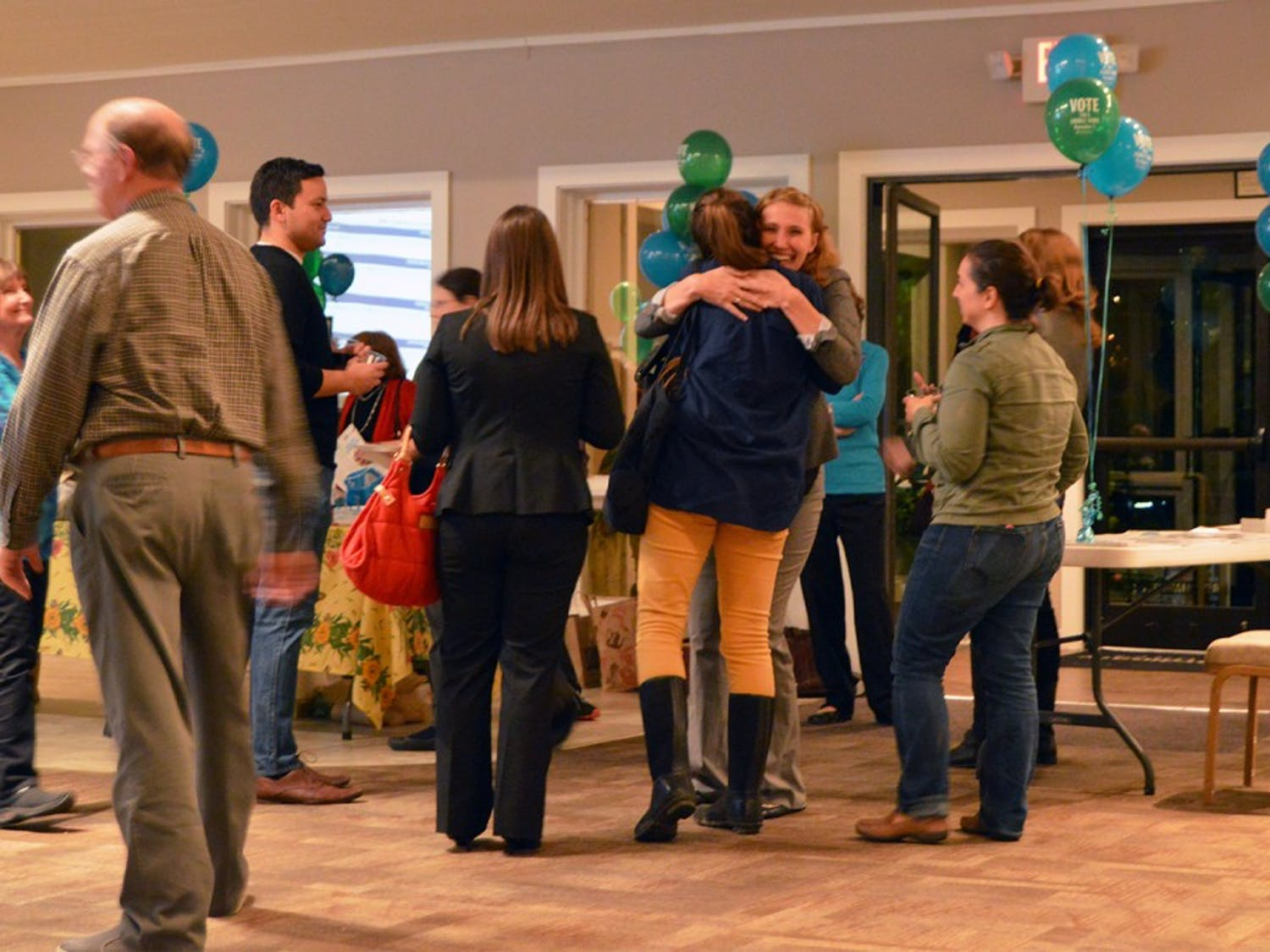 Jessica Anderson hugs a friend after being elected Town Council at the CHALT election party.