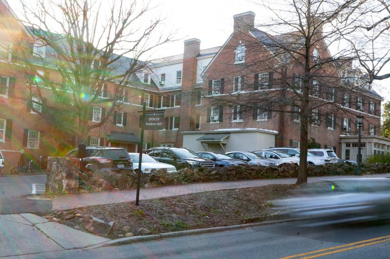 Cars pass by Spencer Residence Hall on Sunday, Mar. 1, 2020. Built in 1924, Spencer was the first all-female residence hall, but is now co-ed.