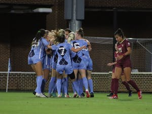 The UNC women's soccer team celebrates Isabel Cox's (13) first goal during the first half of the Tar Heels' home matchup against the Florida State Seminoles at Dorrance Field on Oct. 21. UNC tied FSU 2-2.