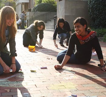 Sophomore business major Jess Hetzel (left) and sophomore international studies major Mitali Dayal participate in Chalking Sidewalks.