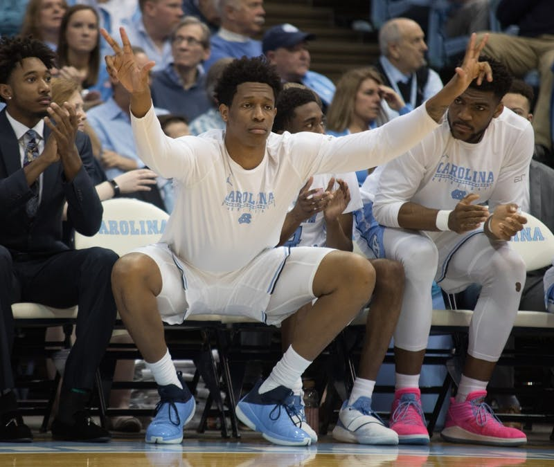 Sophomore Sterling Manley (21) celebrates a three-pointer against Miami  on Saturday, Feb. 9, 2019 in the Smith Center. UNC men's basketball defeated Miami 88-85 in overtime.